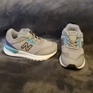 Grey purple and teal New Balance shoes